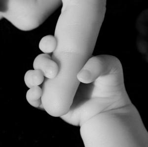 tasi infant hand1 300x299 Capturing Your Treasured Memories